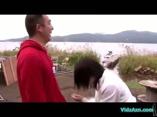Asian Girl On Her Knees Giving Blowjob Cum To Mouth Spitting To Palm Outside At The Lake