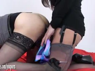 Hot Milf fucks tranny ass with strapon and wanks her hard with nylons