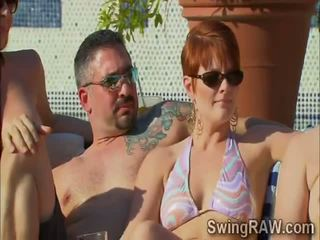 Swinger couples have a party outdoors in XXX reality show