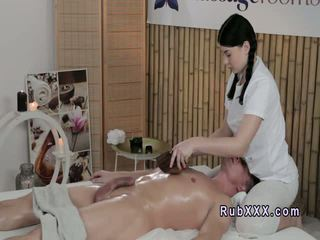 Busty masseuse fucks oiled customer