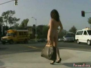 Brunette walks nude near cross road