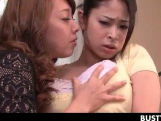 Turned on lesbo jap mistress rubbing her GFs huge tits