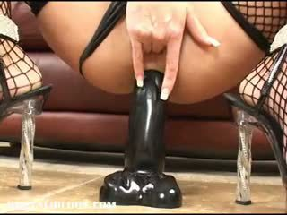Milf Chelsea Zinn gapes her ass with two brutal dildos