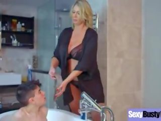 Bulky blonde mom with big tits bathes a skinny boy
