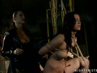 Classy mistress in latex playing with slavegirl