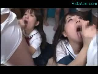 2 Schoolgirls On Their Knees Kissing Sucking Cocks Getting Many Cums To Mouth In The Classroom