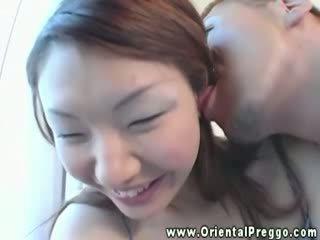 Sexy oriental preggy shows her hot bod...