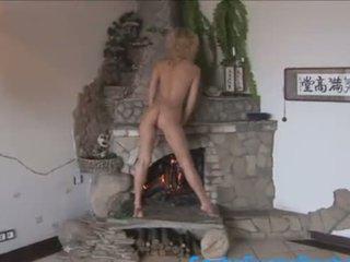 Fucking sexy girl teasing at fireplace