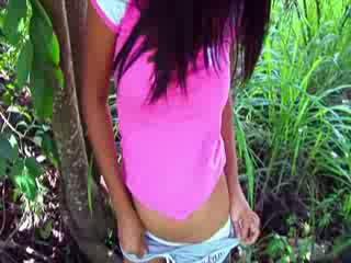 Asian chick fingering in a forest