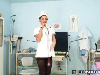 Brunette in nurse uniform plays with her beaver in hospital