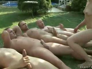 Guys pissing on beautiful girl