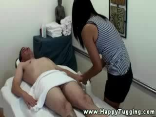 Oriental masseuse tugs and sucks for her client