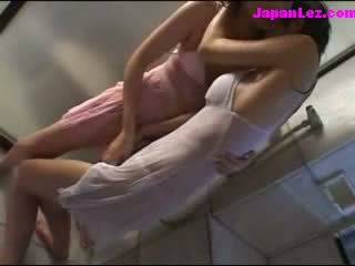 2 Girls In Wet Clothes Kissing Patting Under The Shower