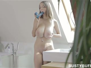 Busty Buffy sucking on big toy
