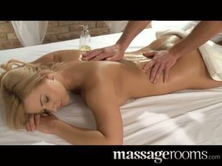 Busty young Nataly Cherie sensually oi...