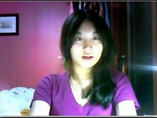 Asiatico giovanissima teasing su cam
